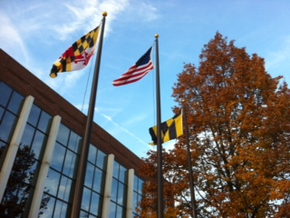 The Maryland, American, and Baltimore flags on the MICA campus. Credit: Stephanie Hughes.