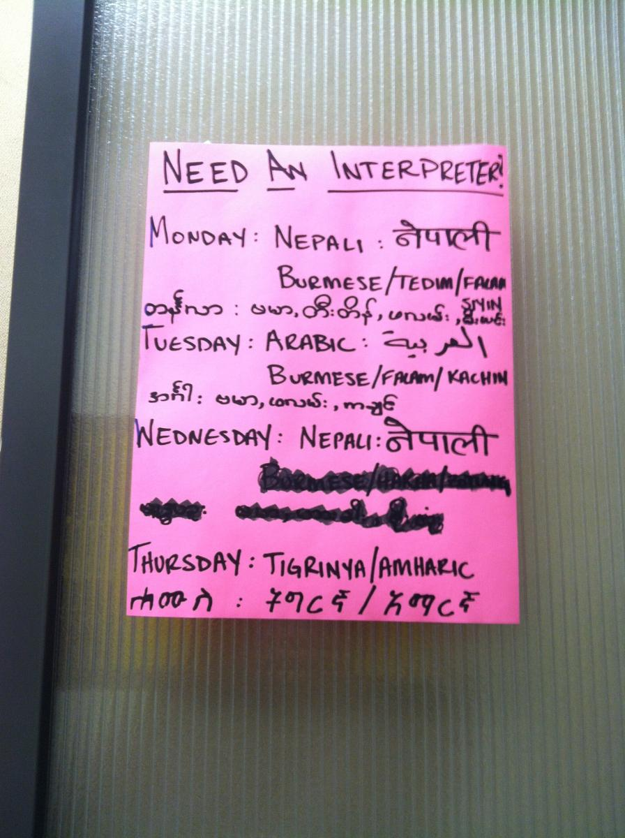A flyer at the IRC in Baltimore that lists the available interpreters every day. Credit: Jamyla Kay